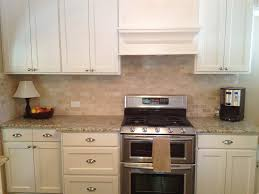 Kitchens With Giallo Ornamental Granite Giallo Fiorito Dark With Tile Backsplash Giallo Ornamental