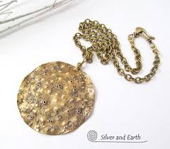 gold brass medallion pendant necklace with hammered organic texture