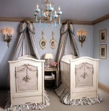 twin baby nursery ideas along with white wooden crib plus nice curtains decoration complete with