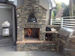 outdoor fireplace with a pizza oven