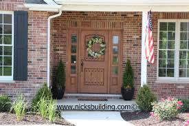 the great american entrance red brick house with tan door door with reef