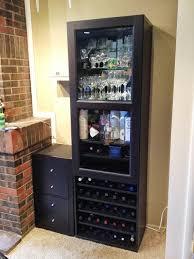 besta wine rack and liquor cabinet