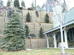 building a timber retaining wall on a slope how to build a retaining wall on steep