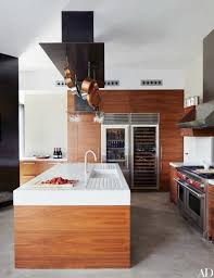 the pot rack and marble top island were custom made for this spanish home by olson kundig architects the refrigerator and wine storage are by sub zero
