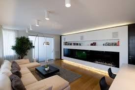 interior white apartment living room ideas with white sectional sofa and gray rug plus black