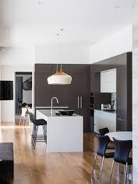 Example of a trendy galley medium tone wood floor and brown floor eat-in  kitchen