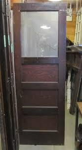 3842 antique three panel door with glass upper