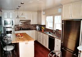 contemporary kitchen design with funnel glass pendant lamps over wooden top kitchen island as well as white cabinets sets decors