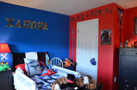 red wall paint black bed: bathroom high black wooden drawers combined with white bed with blue bed sheet on the