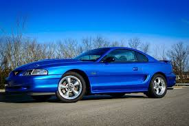 My first mustang was a '95 in this color. LOVED this color ...