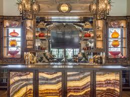 Backlit bar featuring Aria Stone Gallery's Onyx Fantastico. Designed by  DeLeo & Fletcher.