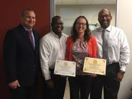 Employee of the Month Tristaca Ebanks with (L-R) Deputy Governor Franz  Manderson, and MHA officials Wesley Howell and Michael Nixon : CNS Local  Life