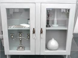 bathroom wall cabinet with glass doors