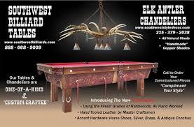 elk antler chandelier above pool table