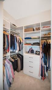 tiny walk in closet customized with drawers and shelves for maximum organization