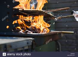 ing lighting fluid fuel on a charcoal bar b q to increase the flames