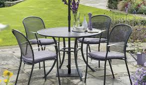 caredo 4 seater dining set with wisteria check seat pads from kettler s classic metal garden furniture