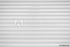 the texture of corrugated metal sheet white or gray galvanizes steel rolling shutter