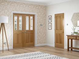 malton pre finished internal oak door with clear bevelled glass lifestyle roomshot 2