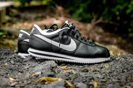 the classic nike cortez refined in leather black white
