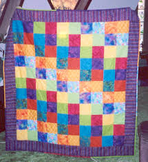 Stolen Quilts listing, can you help find these quilts? & Large colorful lap size quilt stolen in Bakersfield, CA from a storage  locker. Done in bright colorful batiks. It is tied, not quilted. Adamdwight.com