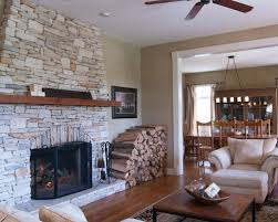 Example of a country living room design in Cincinnati with a stone fireplace