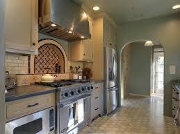 Gray Mediterranean Kitchen Featuring Mosaic Backsplash