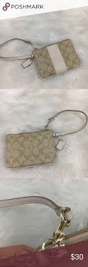 Coach leather Signature Monogram wristlet wallet Signature Monogram design,  leather, small wristlet with zip closure, 2 card slots.