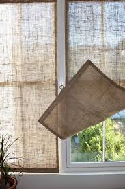 DIY: Window Panels - using burlap, a dowel, thread, a metal ring and a  cleat.