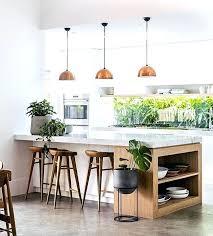 pendant lighting white kitchen white kitchen cement floors copper pendant lighting white green plants wood