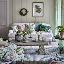 country living room with foliage prints and rustic wooden furniture