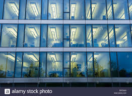 office facade.  facade facade of a modern office building with lights on in the offices  evening munich bavaria germany for office
