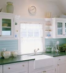 seaglass blue kitchen sink in white and blue kitchen with green counters hutker architects