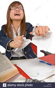 frustrated teenage student tearing up her homework stock photo frustrated teenage student tearing up her homework