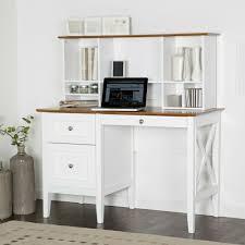 desk drawers white shelves books vases cd laptop