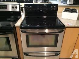 it is a kenmore freestanding electric range black and stainless smooth glass surface top the picture is below