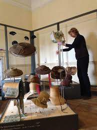 Costume Curator, Althea Mackenzie, installing the Hats & Bonnets ...