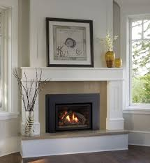 contemporary gas fireplace inserts with white fireplace mantel surround and