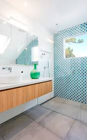the most attention grabbing aspect of this mostly white modern bathroom is the bright blue
