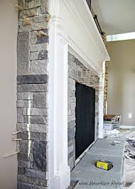 this morning after we took the sticks out we had a stone fireplace i was really tempted to keep the stone gray but since i had already whitewashed part