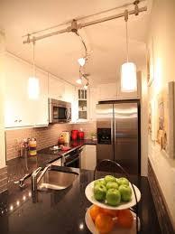 t track lighting. Track-Lighting-Design-For-Small-Kitchen-With-Brick-Backsplash-Also-White-Wooden-Kitchen-Design-Also-White-Painted-Wall-860x1148 - DIAMOND INTERIORS T Track Lighting