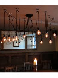 multi pendant with 10 filament lamps hung at diffe drops from black cable