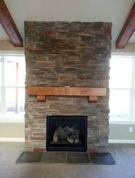 inspiring stone veneer fireplace remodel ideas with thick wood mantel shelf