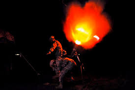 u s department of defense photo essay iers fire a round from a 120mm illumination mortar system during a night training mission on