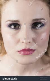 beautiful woman with gentle makeup on bright and clean pink lipstick blue eye