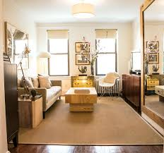Think about the face of your hidden storage. The murphy bed in Garrett's  Everything Every Day apartment hides away during the day behind the grand,  ...