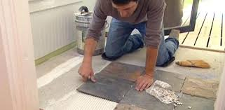 lay on the floor installing vinyl flooring around toilet