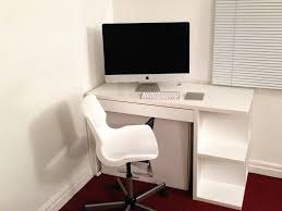 white office desks for home. chic ikea micke desk in white with chairs and computer set before the wall for office desks home