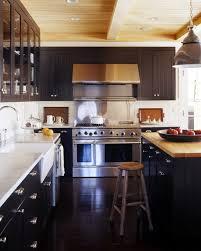 robert stillin black kitchen with butcher block countertops remodelista