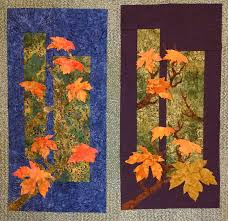 two student quilts from my maplewood pattern made in a triadic color scheme